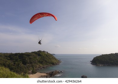 paraglider above a sea in Puket, Thailand.