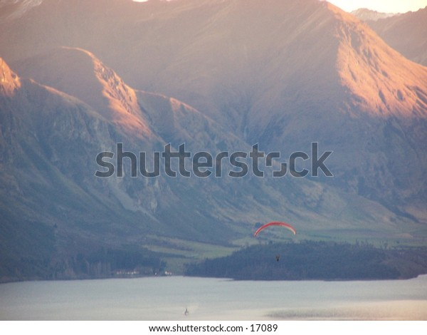 Paraglider amongst mountains