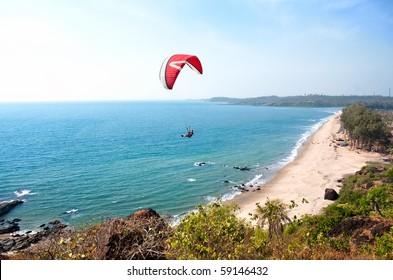 Paraglider and  Beautiful Tropical beach ,Goa, India