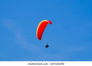 Paraglider in the blue sky at the Kampenwand in Bavaria, Germany