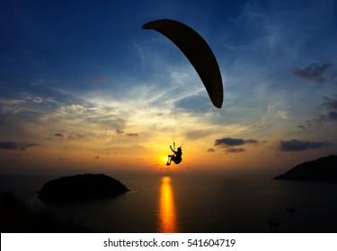 Paraglider chasing the sunset. Promthep Cape, Phuket, Thailand.