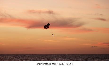 Paraglider during sunset at Patong Beach near Phuket, Thailand.