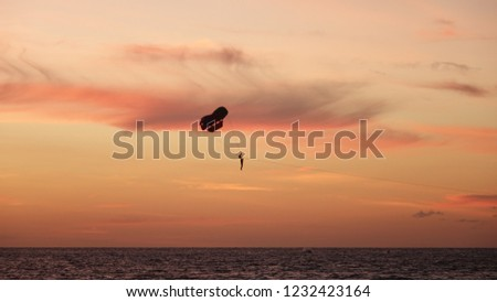 paraglider-during-sunset-patong-beach-45