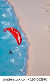 Paraglider flies in the sky - Iztuzu beach, Turkey