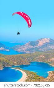 Paraglider flies in the sky - Oludeniz, Fethiye