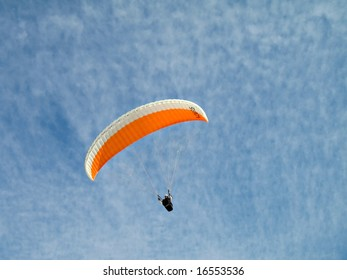 A paraglider is flying