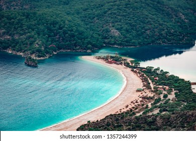 Paraglider flying on Oludeniz beach in Fethiye, Mugla, Travel destination. Summer and holiday concept. Lycian way. Panoramic view.