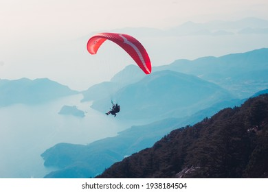 Paraglider flying on Oludeniz beach in Fethiye, Mugla. Travel destination. Summer and holiday concept.