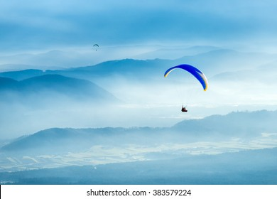 Paraglider flying over the clouds. No limits, paragliding above the clouds.