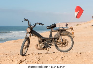 Paraglider groundhandling when seen on top of a pannier rack of a motorbike on a beach in Morroco Aglou Tiznit
