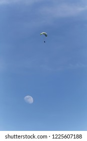Paraglider high in the sky above the moon over Lake Annecy  France