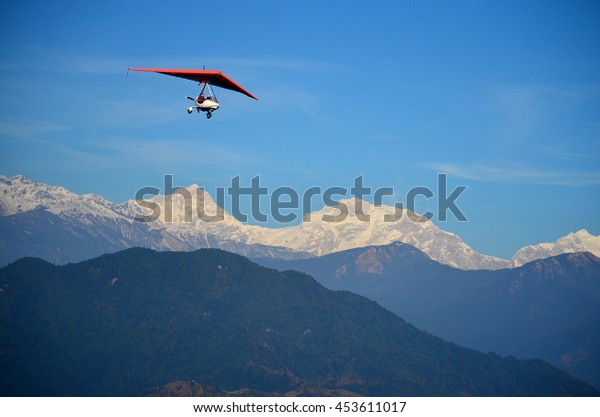 Paraglider with Himalayan background