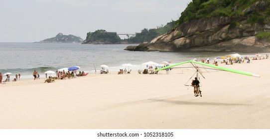 Paraglider landing on Copacabana beach of Rio de Janeiro, Brazil