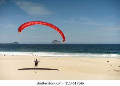 Paraglider on the beach of San Conrado in Rio de Janeiro.