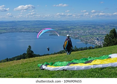 Paraglider over the Zug city, Zugersee and Swiss Alps, Zug mountain, Switzerland