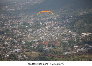 Paraglider Playing Paralayang Sport In Batu City East Java Indonesia