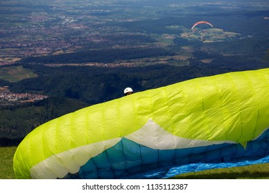 Paraglider preparing his parachute before taking off