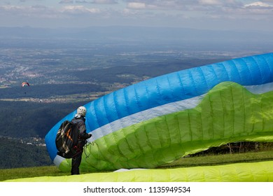 Paraglider in starting position waiting for the right wind