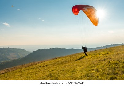 Paraglider in sunny day flying in Palava, hill Devin, South Moravia, Czech Republic