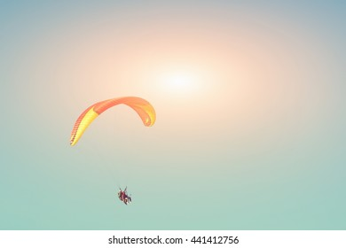 Paraglider in the sunny sky