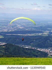 Paraglider taking off from from the edge of a mountain