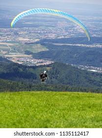Paraglider taking off from Kandel mountain near Freiburg