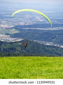Paraglider taking off from from the Kandel mountain near Freiburg
