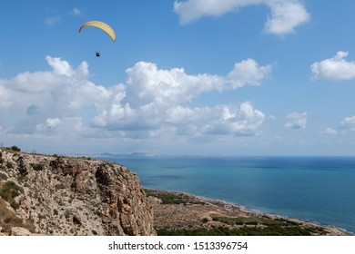 Paraglider tandem flying over the sea in bright day. View from Santa Pola lighthouse, Alicante, Spain - Shutterstock ID 1513396754