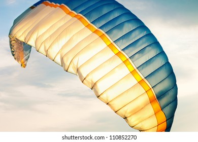 paraglider wing in air against sky