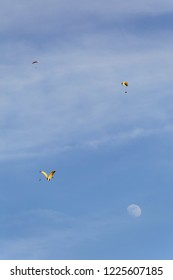 Paragliders flying around the moon in the sky above Lake Annecy France