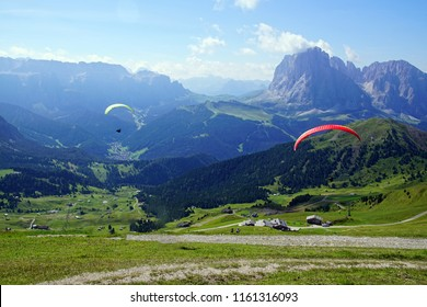 Paragliders launched from a high alpine meadow in the Dolomites Alps, Italy
