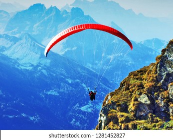 Paragliders on the mountain chain Churfirsten and above Lake Walensee - Canton of St. Gallen, Switzerland