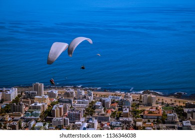 Paragliders over the City of Cape Town, view from Signal Hill. South Africa.