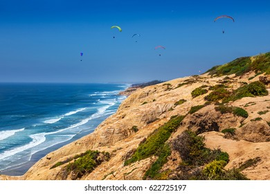 Paragliders from the Torrey Pines gliderport just north of San Diego, California