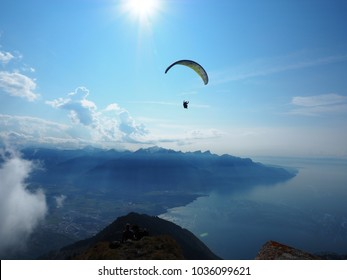 Paragliding above lake Geneva with Alps in background