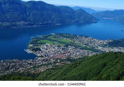 Paragliding above Lake Maggiore in Ticino with Locarno and Ascona
