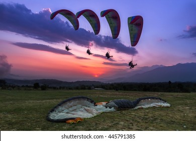 Paragliding is an aerial sport where you can let your body be free and feel that chill of the wind flying several thousands of meters high in the sky. Action shot of a para-glider landing