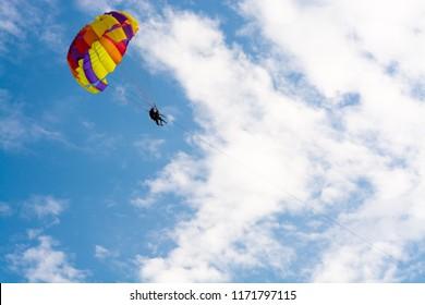 Paragliding along beautiful coastline