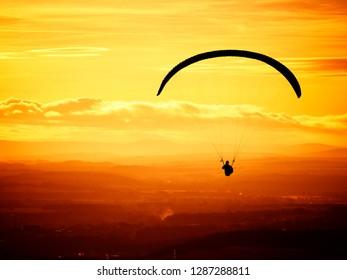 paragliding at beautiful sunset