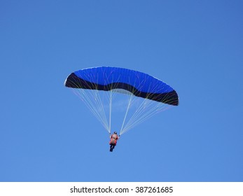 Paragliding in a clear blue summer sky