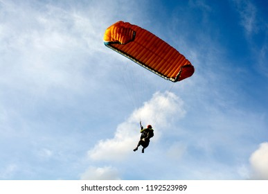 Paragliding is an extreme sport and recreation.Paragliding in the blue sky.Paragliding.