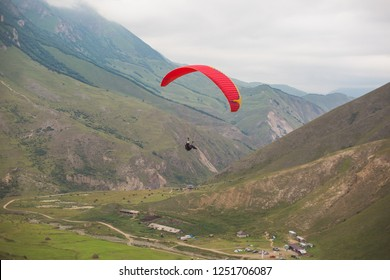 Paragliding flies in the mountains. Rocks and stones. Adrenalin. Extreme sport