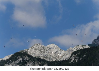 Paragliding high in the blue sky above La Tournette above Lake Annecy  France