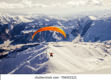 Paragliding in high mountains, winter time