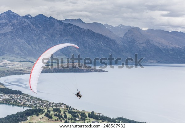 Paragliding with instructor above lake Wakatipu, Queensland, Otago, New Zealand