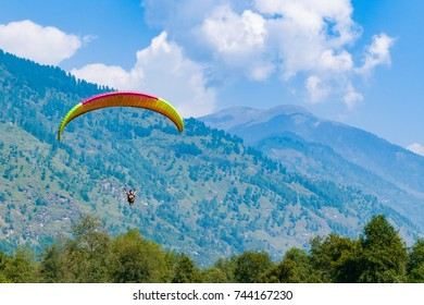 Paragliding at Kullu Valley near  Manali at Kullu, Himachal Pradesh, India.