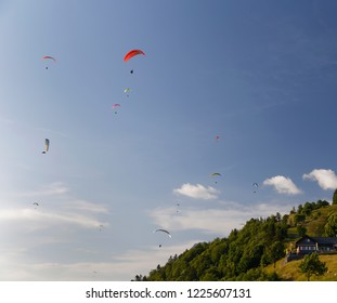 Paragliding in the late evening sun from Col de la Forclaz above Lake Annecy France
