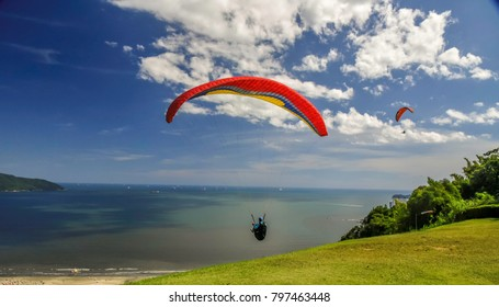 Paragliding in the mountain close to the beach and city