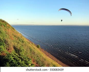 Paragliding near the river bank