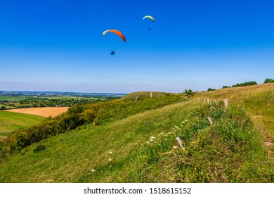 Paragliding off the Dunstable Downs Chiltern Hills in Bedfordshire on a hot summers July afternoon
